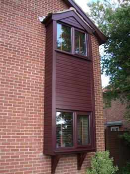 Rosewood windows with rosewood Toungy & Groove Cladding
