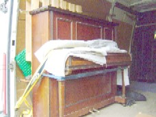 piano strapped in for its journey