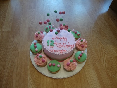 Why not have a cake with cupcakes around or a tier of cupcakes.