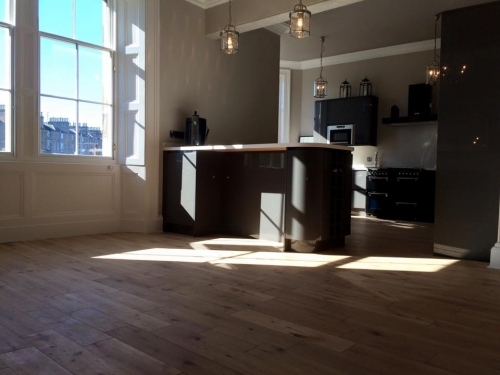 Stunnng fully fitted kitchen wth engineered oak flooring layed throughout