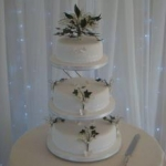 Logo - Lily of the Valley and Butterflies wedding cake