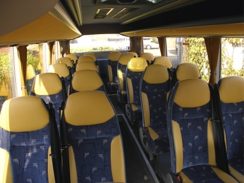 This is an interior shot of one of our 22 seater vehicles with three point belts, double glazing, reclining seats and air-con.