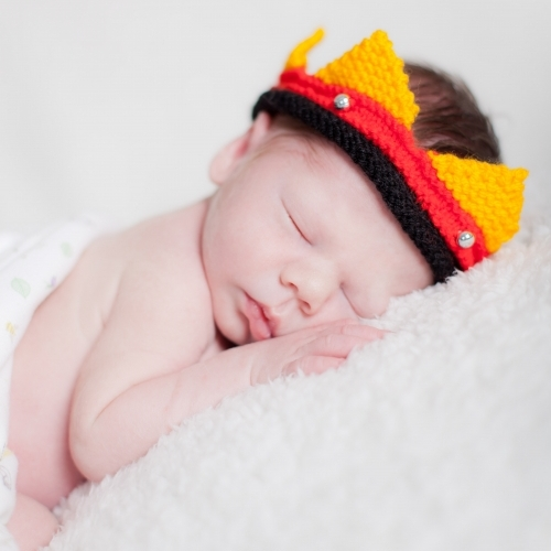 Sleeping Newborn Wearing Hat