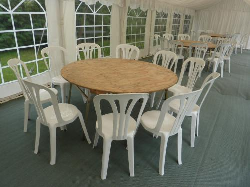 5' round table with 10 chairs in a 4m wide marquee Marquee Hire Peterborough