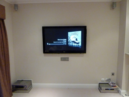 TV on false wall with all cables hidden.