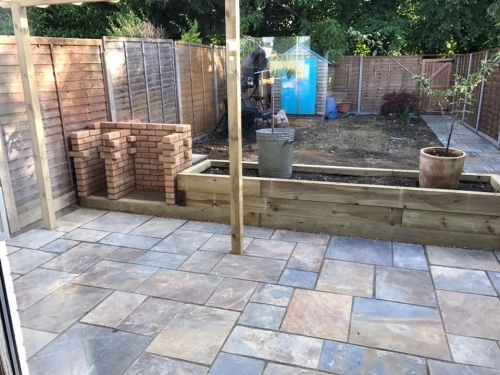 Custom built brick BBQ, raised flower beds, picture taken before turfing and sealing of patio