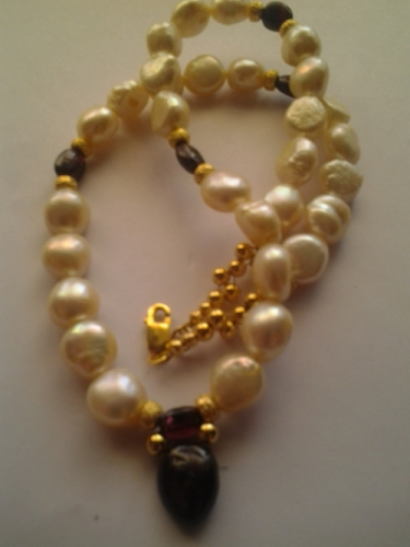 "16"" Baroque Pearls and Garnet Necklace with 925 Gold Plated Sterling Silver clasp and Beads with a Large Garnet cavachon pendant. £121.00 Code:00018"