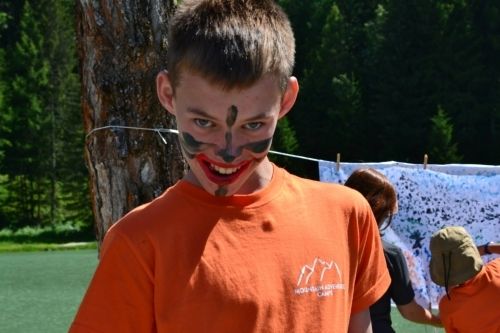 Getting carried away with some face painting during an art session at Mountain Adventure Camps