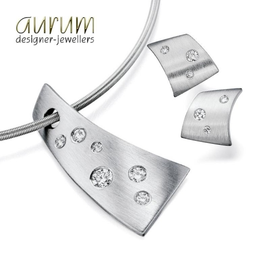 Contemporary platinum pendant and earrings with scattered diamonds