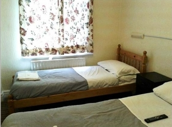 Twin room at Holly House Hotel London