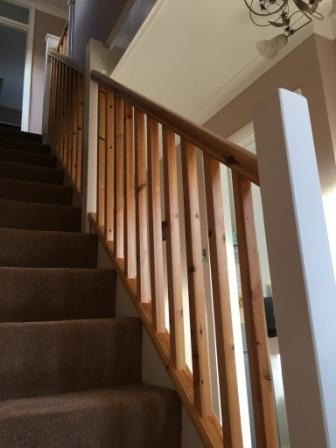 Simple classy modern stair case, using satin varnish on the handrails and spindles, and white gloss on the other woodwork.